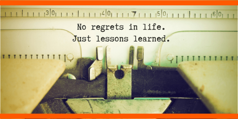 An old fashioned type writer frames the text: No regrets in life. Just lessons learned.