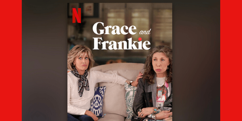 Screenshot of Netflix comedy series Grace and Frankie. Jane Fonda (Grace) and Lily Tomlin (Frankie) sit together on a couch, pouting.