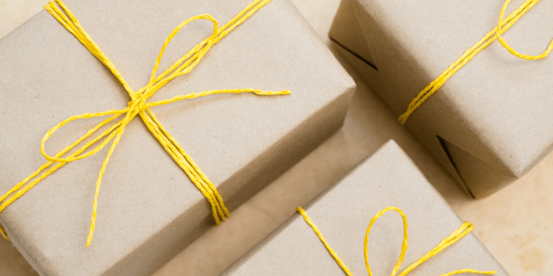 Packages are wrapped in yellow twine and brown paper, ready to be delivered.  Old fashioned methods of communicating such as sending letters and packages can help us stay connected as we shelter in place.