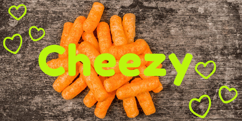 Hearts surround a pile of Cheetos snacks emblazoned with the name Cheezy. A tribute to my short-lived first love, a mistake I've made peace with. Do memories of past mistakes make you wince? Make peace with your past and you'll find more joy in the present. We all live and learn!