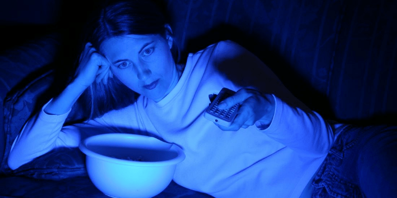 How important is sleep? Let me put it this way. If you want to improve your quality of life in every way, sleep should be at the top of your list. You will look better, feel better, and live longer. The blue light of a TV screen is the only light in the room. Cut back on screen time for a good night's sleep.